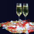 Glasses of champagne decorated, on a black background — Stock Photo