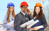 A man and woman architect team on construction site — Stock Photo
