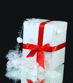 New year's gift decorated on a black background — Zdjęcie stockowe
