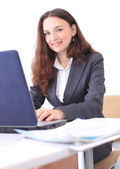Thoughtful business woman in an office smiling. — Stock Photo