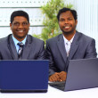 Stock Photo: Two african-americin office work of laptop.