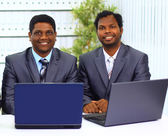 Two african-american in the office work of the laptop. — Stock Photo