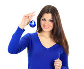 Smiling girl with christmas balls — Stock Photo