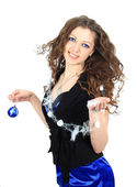 Smiling girl with christmas balls — Стоковое фото