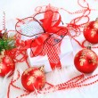 Christmas gift with red balls bow — Stock Photo #8134129