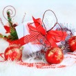 Christmas gift with red balls bow — Stock Photo