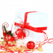 Christmas gift with red balls bow — Stock Photo #8134220