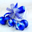 Stock Photo: Festive balls with gift box on snow