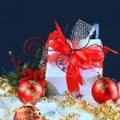 Christmas gift with red balls bow - Stock Photo