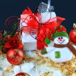 Christmas gift with red balls bow — Stock Photo #8134584