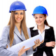 An attractive diverse woman architect team on construction site — Stock Photo #8410528