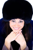 Beautiful girl in a fur hat — Stock Photo