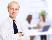 Beautiful business man. Negotiations in the office — Stock Photo