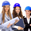 Three women architect team. Isolated on a white background. — Stock Photo