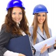 An attractive diverse woman architect team on construction site — Stock Photo