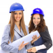 An attractive diverse woman architect team on construction site — Stock Photo #8479800