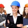 Two women and a man architect team. Isolated on a white background. — Stock Photo