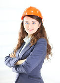 The beautiful business woman the engineer on a white background — Stock Photo