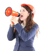 The beautiful business woman the engineer shouts in the shoutbox on a white — Stock Photo