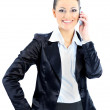 Nice business woman talks on the phone. Isolated on a white background. — Stock Photo #8750474