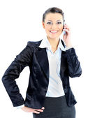Nice business woman talks on the phone. Isolated on a white background. — Stock Photo