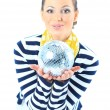 Stock Photo: Beautiful girl with a mirror sphere on a white background.