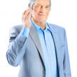 Nice businessman at the age of talking on the phone. Isolated on a white background. — Stock Photo