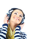 Beautiful girl with headphones. Isolated on a white background — Stock Photo