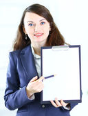 Portrait of a cute young business woman with the work plan smiling. — Stockfoto