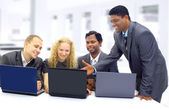 Interracial business team working at laptop in a modern office — Stock Photo