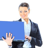 Beautiful businesswoman keeps the laptop. — Stock Photo
