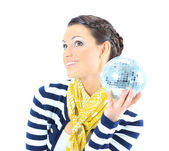 Beautiful girl with a mirror sphere on a white background. — Stockfoto