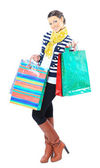Portrait of a happy young adult girl, with color-coded bags. — Stock Photo