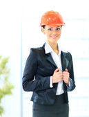 A woman engineer in a suit and a helmet. — Stock Photo