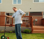 Backache while doing yard work — Stock Photo
