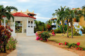 Tropical resort gazebo and gardens — Stock Photo
