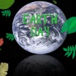 Earth day concept with planet surrounded by leaves for conservation — Stok fotoğraf