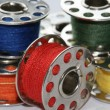 Stock Photo: Collection of colorful sewing bobbins
