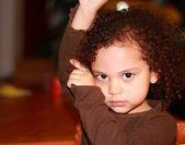 Cute little girl posing the cha cha — Stock Photo