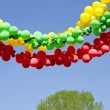 Colorful balloons garland and sky — Stock Photo