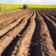 Stock Photo: Spring tillage in ground and tractor