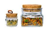 Isolated calendula and chamomile tea jars — Stock Photo