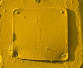 Yellow painted metal background — Stockfoto