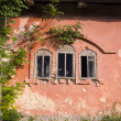 Old building wall with three windows — Stockfoto