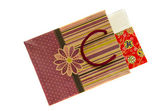 Isolated paper bag with gift box — Stock Photo