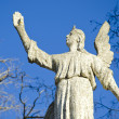Ancient angel on sky background — Foto de Stock