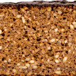 Various grains ecological black bread - Stock Photo