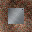 Brushed aluminum plate bolted to a grudge and rusted diamond metal background - Stock Photo