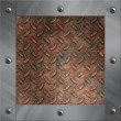 Brushed aluminum frame bolted to a grudge and rusted diamond metal background — Stock Photo