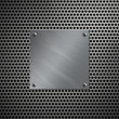 Royalty-Free Stock Photo: Brushed aluminum plate bolted to a perforated metal background